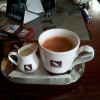 Photo taken at Delicia Caffe by Vasile C. on 11/7/2011