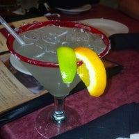 Photo taken at Lone Star Steakhouse & Saloon by Juan Diego C. on 8/19/2012