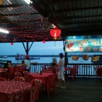 Photo taken at 港村海鲜楼 Port Village (Tanjung Harapan) by Calvin L. on 1/19/2012