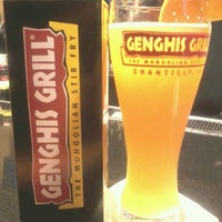 Photo taken at Genghis Grill by Charmaine C. on 12/23/2011