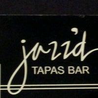 Photo taken at Jazz'd Tapas Bar by Jackie C. on 3/23/2012