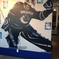 Photo taken at Canucks Team Store Outlet by Jeff H. on 4/1/2012