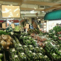 Photo taken at Village Grocer by T K. on 3/18/2012