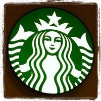 Photo taken at Starbucks by Porachon S. on 4/20/2012