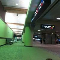 Photo taken at Terminal 3 by Jamie V. on 4/19/2012
