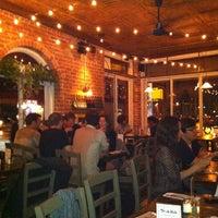 Photo taken at Sidewalk Bar & Restaurant by Alexia L. on 6/2/2012