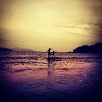 Photo taken at Praia Dura by Julia G. on 2/22/2012