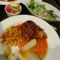 Photo taken at Kenny Rogers Roasters by Louisa P. on 7/20/2012
