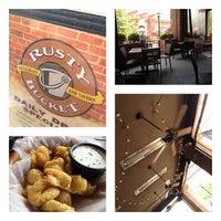 Photo taken at Rusty Bucket Restaurant and Tavern by Matt S. on 5/27/2012