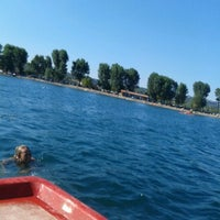 Photo taken at Spiaggia Libera Lago di Bolsena by Ginger B. on 8/18/2012
