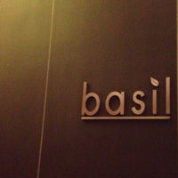 Photo taken at Basil Restaurant by Hannah K. on 7/24/2012