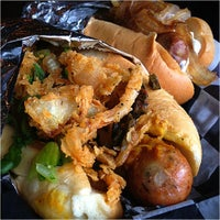 Photo taken at Biker Jim's Gourmet Dogs by Rob Y. on 9/10/2012