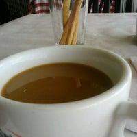 Photo taken at Corelli's Italian Cafe by Alexia N. on 5/19/2012
