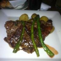 Photo taken at La Laguna Restaurant & Lounge by Mario M. on 8/3/2011