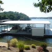 Photo taken at Stokes Dock Co., Inc. by Stokes Dock Co. - Waterfront Living Specialists on 9/24/2011
