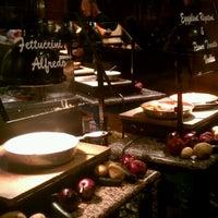 Photo taken at Cinzzetti's Italian Market Restaurant by Jill P. on 12/4/2011