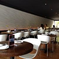 Photo taken at Osha Thai Restaurant & Bar by Yulia L. on 7/8/2012