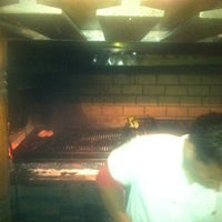 Photo taken at Steakhouse Martin Fierro by Sam S. on 5/24/2012