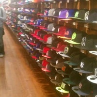 Photo taken at New Era Flagship Store: New York by XChocoX .. on 4/14/2012