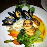 Photo taken at Higgins Restaurant & Bar by Janet J. on 10/31/2011