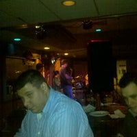 Photo taken at Gin Mill Lounge by Jeremy O. on 2/5/2012