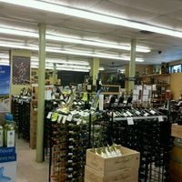 Photo taken at Downtown Wine & Spirits by Jay N. on 9/6/2011