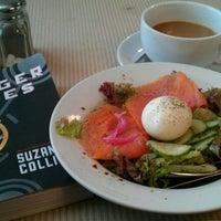 Photo taken at Iris Cafe by Liza G. on 8/24/2011