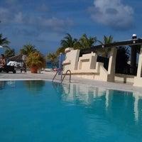 Photo taken at Bucuti Pool by Benjamin L. on 1/15/2012