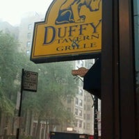 Photo taken at Duffy's Tavern & Grille by Laura W. on 8/20/2011