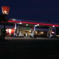 Photo taken at Engen 1 Stop & Quickshop by Neil B. on 4/7/2011