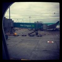Photo taken at Gate 406 by Simon F. on 3/21/2012