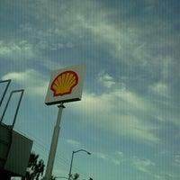 Photo taken at Shell by Jenn V. on 9/8/2012