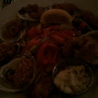 Photo taken at Dock's Oyster House by Jonathan A. on 8/21/2011