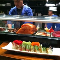 Photo taken at Sushi Zushi by Angie M. on 12/17/2011