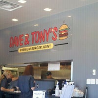 Photo taken at Dave & Tony's Premium Burger Joint by Ryan B. on 10/2/2011