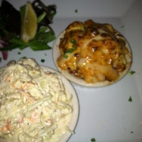 Photo taken at Luna Del Sea Steak and Seafood Bistro by Valerie C. on 8/10/2012