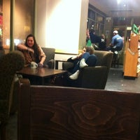 Photo taken at Starbucks by Andrew C. on 12/12/2011