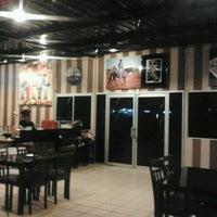 Photo taken at COWBOY Steak House by Kion R. on 12/10/2011