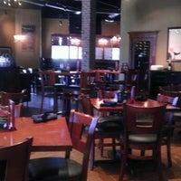 Photo taken at Bricks Kitchen & Pub by Jodi B. on 8/21/2011