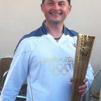 Photo taken at Olympic Torch Relay by Louise D. on 5/26/2012