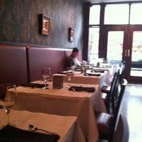 Photo taken at Aquitaine Restaurant by Sue C. on 10/4/2011