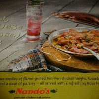 Photo taken at Nando's by Nouman Z. on 12/24/2011