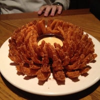 Photo taken at Outback Steakhouse by sophia l. on 6/7/2012