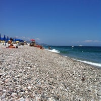 Photo taken at Spiaggia Di Fondachello by Tiziana C. on 8/17/2011