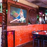 Photo taken at Manjares Restaurant by Oscar M. on 7/31/2011