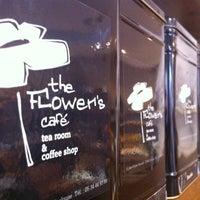 Photo taken at Flower's Café by Artemis C. on 7/5/2012