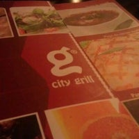 Photo taken at City Grill by Cosmin E. on 11/15/2011