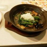 Photo taken at Gusto by Tatsuhiko M. on 3/24/2012