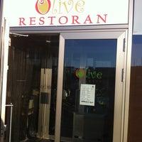 Photo taken at Olive restaurant by Veljo H. on 7/19/2011