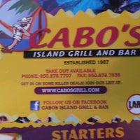 Photo taken at Cabo's Island Grill & Bar by Michael S. on 12/24/2011